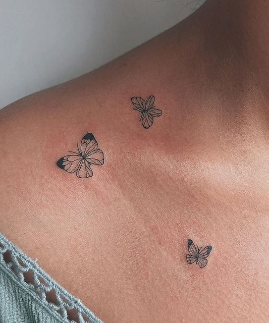 butterfly tattoo on woman's chest
